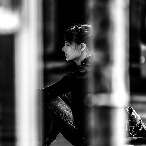 """""""Waiting Around the Corner"""" One Person Real People Side View Lifestyles Young Adult Women Focus On Foreground Looking Selective Focus Day Looking Away Leisure Activity Casual Clothing Young Women Profile View Beautiful Woman Hairstyle Contemplation The Art Of Street Photography My Best Photo"""