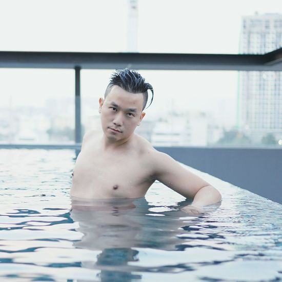 EyeEm Selects Water Swimming Pool Swimming Portrait Men Shirtless Front View Confidence  Thoughtful Monsoon Rainy Season Day Dreaming Wet Hair Office Building Bikini Shampoo Introspection Reflection Drop Hand On Chin Taking A Bath Contemplation Hair Toss Boredom Pensive Uncertainty  Shore RainDrop Thinking