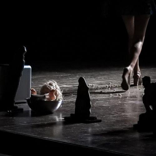 Low section of woman walking in darkroom