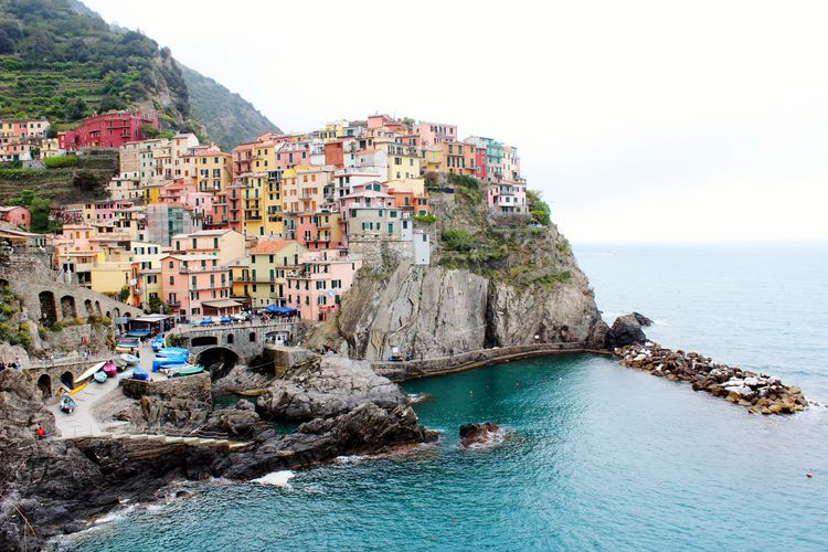 Sea Building Exterior Water Built Structure Architecture Residential Structure House Cliff Town Residential Building Waterfront Residential District Rock - Object Clear Sky Coast TOWNSCAPE Rock Formation Coastline Rock Travel Destinations Italy Cinque Terre Colorful Colors Battle Of The Cities
