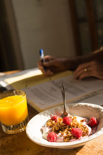 Healthy breakfast of orange juice, yogurt, granola and berries Bowl Close-up Dairy Day Focus On Foreground Food Freshness Indulgence No People Orange Juice  Organic Ready-to-eat Selective Focus Served Serving Size Still Life Temptation Yogurt