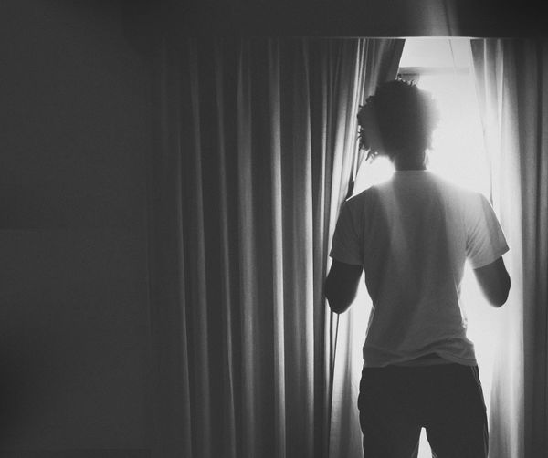 2017 Blackandwhite KWS Photography PhonePhotography Trinidad And Tobago Trinidad's Photography Curtain Rear View One Person Indoors  Standing Three Quarter Length One Man Only Window Young Adult Looking Through Window The Portraitist - 2018 EyeEm Awards