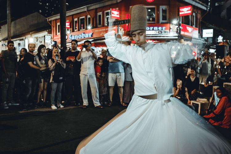 Dance of the divine Dervish Whirlingdervish Sufi Dance Event Positive Emotion Celebration Group Of People City Ottoman Turkey Osmanlı Religious  Divine Euphoria Costume Tradition Sema White Robe Swirl Ecstacy Ecstatic Love God