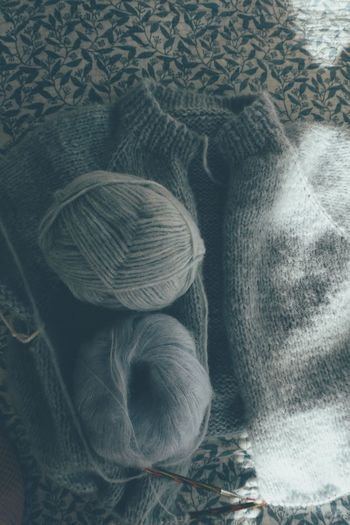 High angle view of wool on bed