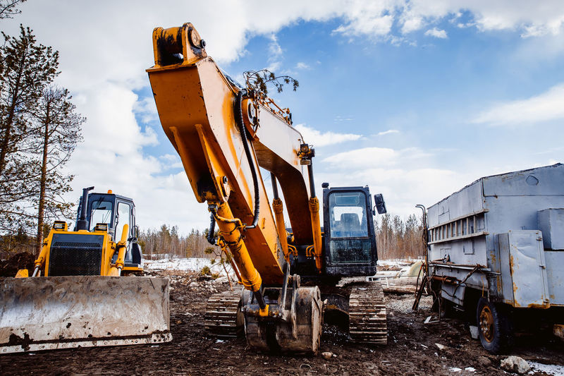 Building - Activity Construction Machinery Construction Site Construction Vehicle Day Digging Earth Mover Industry Machinery No People Outdoors Sky Transportation Working