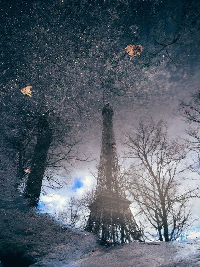 Reflection of eiffel tower on puddle during monsoon
