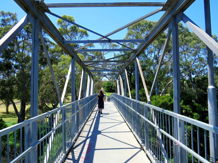 Beams Metal Structure Shadows Outdoors Walking One Person Clear Sky Travel Australia Summer Tree Footbridge Full Length Bridge - Man Made Structure Railing Sky Architecture Built Structure Elevated Walkway Pedestrian Bridge Crossing My Best Photo Humanity Meets Technology 17.62° The Street Photographer - 2019 EyeEm Awards The Architect - 2019 EyeEm Awards