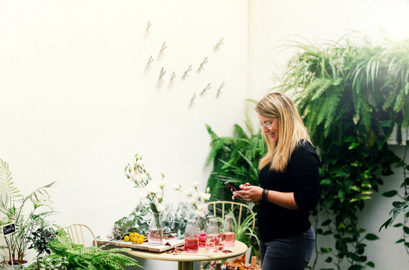 Young woman standing by food on plant