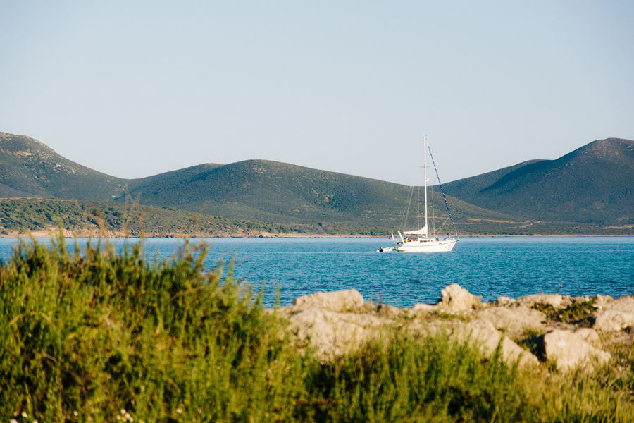 Sailing Nikon D5200 VSCO Beach Beauty In Nature Clear Sky Day Harbor Landscape Mast Mountain Nature Nautical Vessel Nikonphotography No People Outdoors Panoramic Sailboat Sailing Scenics Sea Sunny Tranquil Scene Tranquility Travel Travel Destinations Vacations Water Yacht