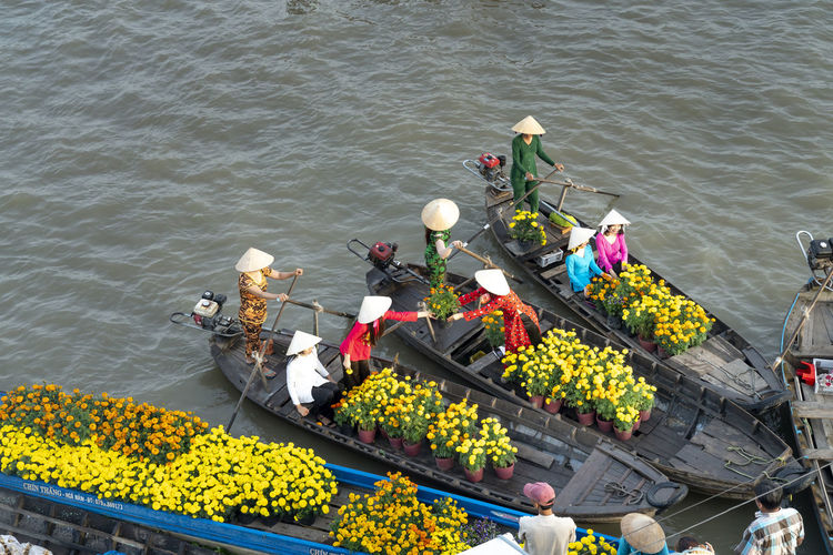High angle view of people floating on river