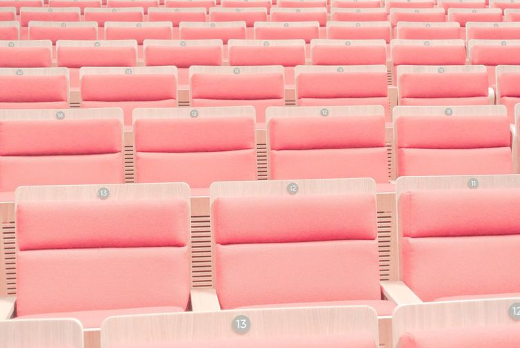 In A Row Seat Full Frame Backgrounds Empty Indoors  No People Pink Color Large Group Of Objects Red Repetition Side By Side Chair Order Arrangement