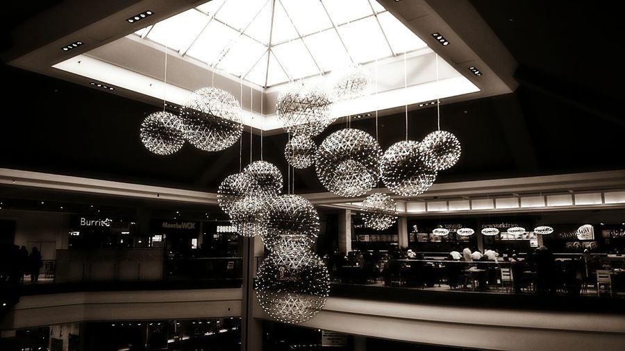 ...shining orbs (in monochrome)... Shining Orbs Scenes From A Mall From My Point Of View Atmospheric The World Around Me EyeEm Gallery Shopping Mall Shopping Center Lights Spheres Sony Xperia Sky Light Center Piece Chandelier Orbs Upper Level Center Focus Atmospheric Mood Redo Monochrome Black And White Alternate Edit Edit Fun With Filters