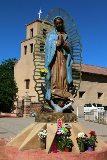 Catholic Shrine Sante Fe New Mexico Sante Fe Railyard District Oldest Shrine To Out Lady Of Guadalupe Our Lady Of Guadalupe EyeEm Selects Sculpture Statue City Tree Clear Sky Religion Human Representation Sky Sculpted