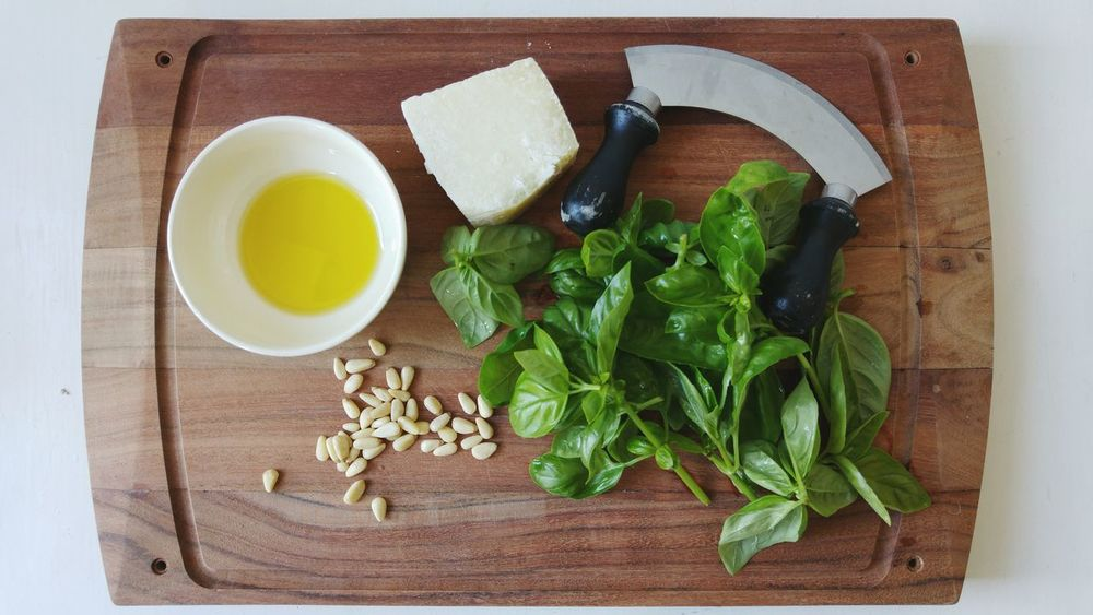 Food And Drink Indoors  Healthy Eating Vegetable Freshness High Angle View Ingredient Herb Cutting Board Studio Shot No People Directly Above Preparation  Green Color Food Basil Pine Nut Day Pesto Pesto Preparation Olive Oil Parmesan Parmesan Cheese Parmeggiano Cheese