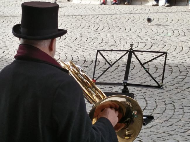 Musician from Upper Austria, performing alpine and classical tunes Walking Around The City  Music Musician Street Musician Top Hat Portrait Cobblestone Hornet Brass. Artist Street Artist TakeoverMusic Your Ticket To Europe