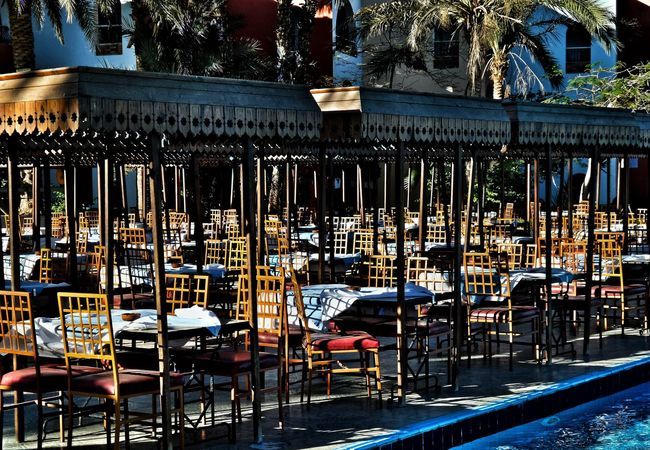 The Calm Before The Storm Empty Chairs Restaurant Scene In The Sunshine Day Abundance Outdoors No People Large Group Of Objects Close-up Tourism Destination Midday Heat Wooden Chairs Beliebte Fotos The Still Life Photographer - 2018 EyeEm Awards