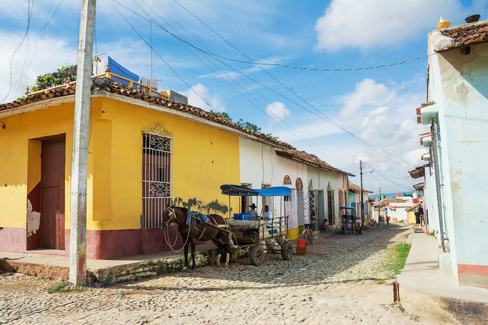Trinidad, Cuba - 8 december: 2017: Horse drawn cart on a street in Trinidad Cuba Trinidad Architecture Cart Cart Horse Cuban Life Horse Horse-drawn Street Town Trinidad, Cuba Urban