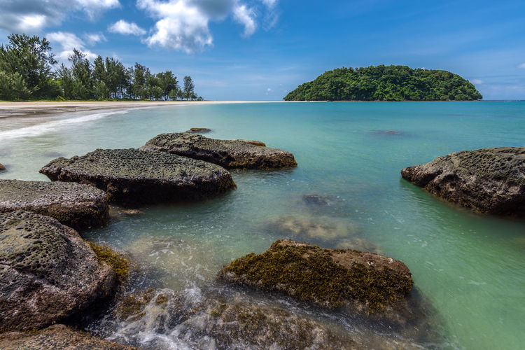 A beautiful setting of a small island with a walkable sand band in the region of the Tip of Borneo, Malaysia. Borneo Beauty In Nature Cloud - Sky Day Idyllic Island Land Long Exposure Nature No People Outdoors Plant Rock Rock - Object Scenics - Nature Sea Shallow Sky Solid Tranquil Scene Tranquility Tree Turquoise Colored Water