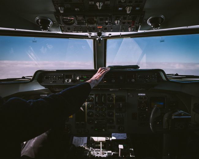 Person In Cockpit Of Airplane