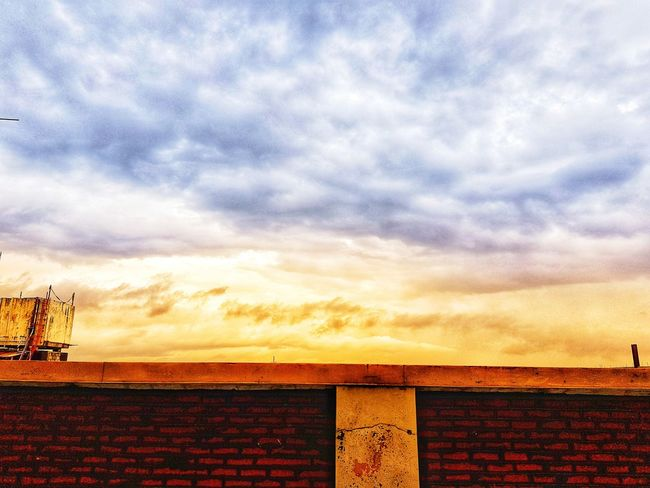 #photography #Nature  #JustMe #sky #filters S8Photography Samsungphotography #rainydays Sunset Roof Sky Architecture Building Exterior Built Structure Cloud - Sky Thatched Roof Calm Sunshade Stilt