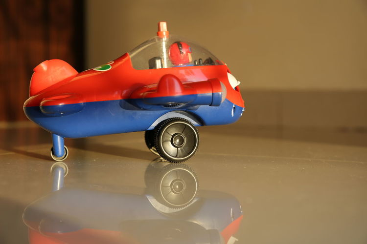 Close-Up Of Toy Airplane On Tiled Floor At Home