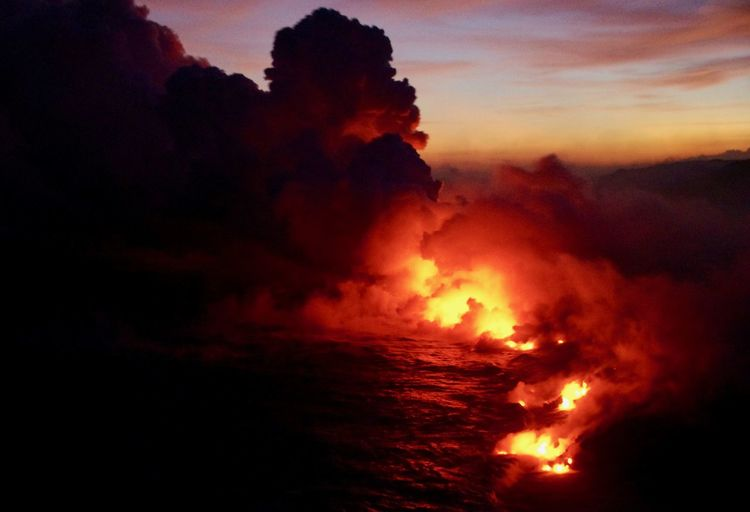 Beauty In Nature Burning Flame Nature Orange Color Scenics Sea Sky Sunset Volcano In The Evening
