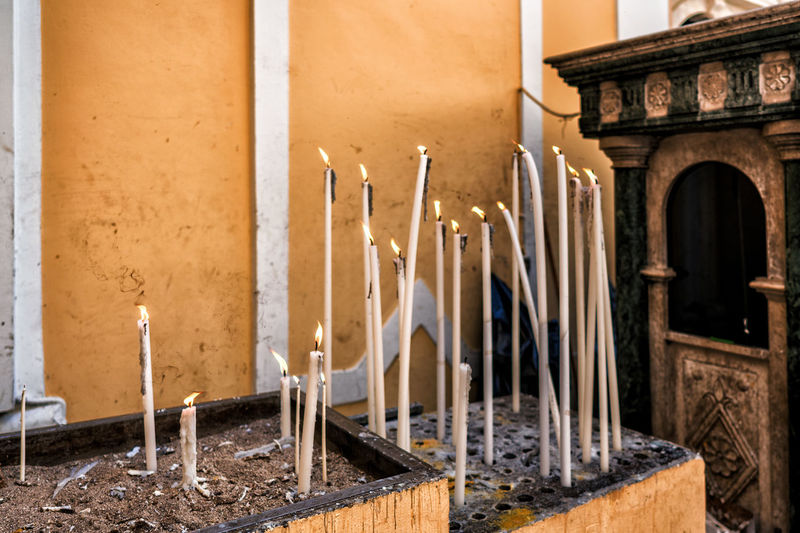 Lit candles in church