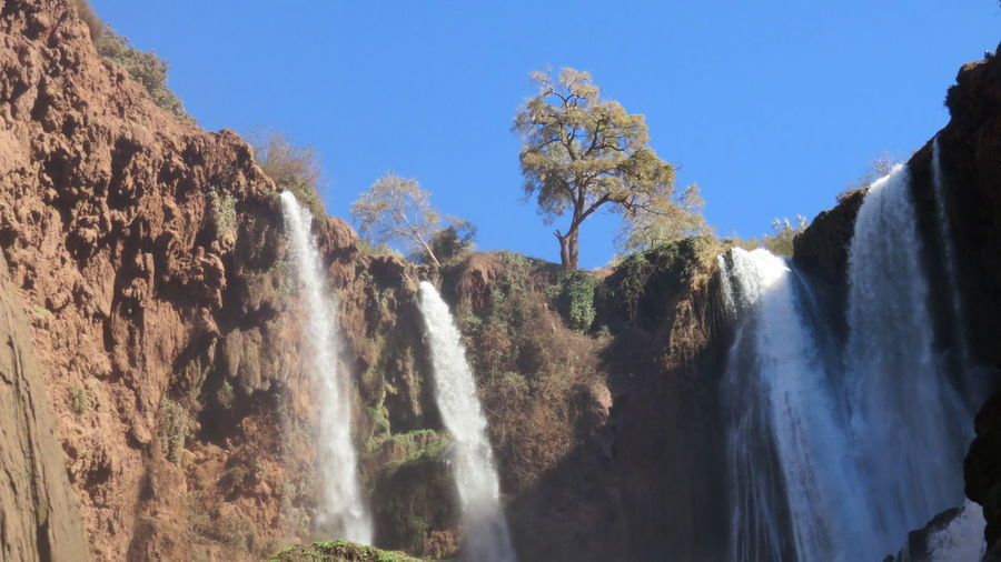 ouzoud waterfalls in morocco Boats Morocco Mountains Nature Ouzoud Falls Rocks Travel Destinations Trip Waterfalls