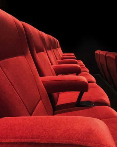 Empty red seats at theater