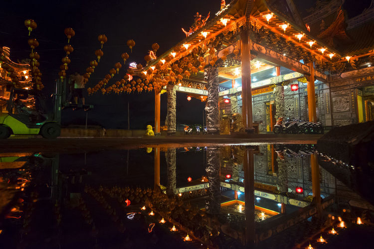 Benoa, Bali, Indonesia - January 28, 2017 : People praying and wishing a happy chinese new year on vihara satya dharma. Amusement Park Amusement Park Ride Architecture Arts Culture And Entertainment Building Exterior Built Structure Decoration Glowing Illuminated Light Lighting Equipment Luxury Nature Night No People Outdoors Reflection Travel Destinations Water Waterfront