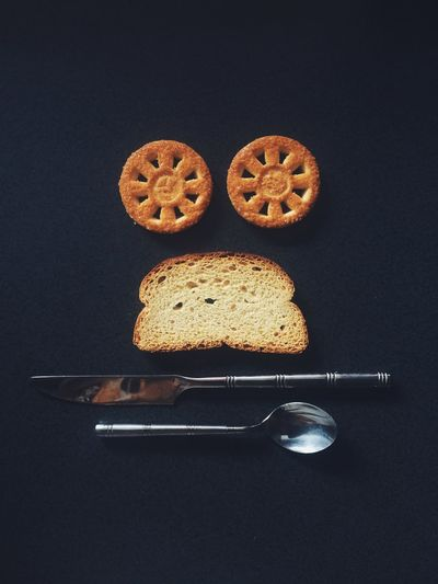 High angle shot of slice of bread cookies knife and spoon
