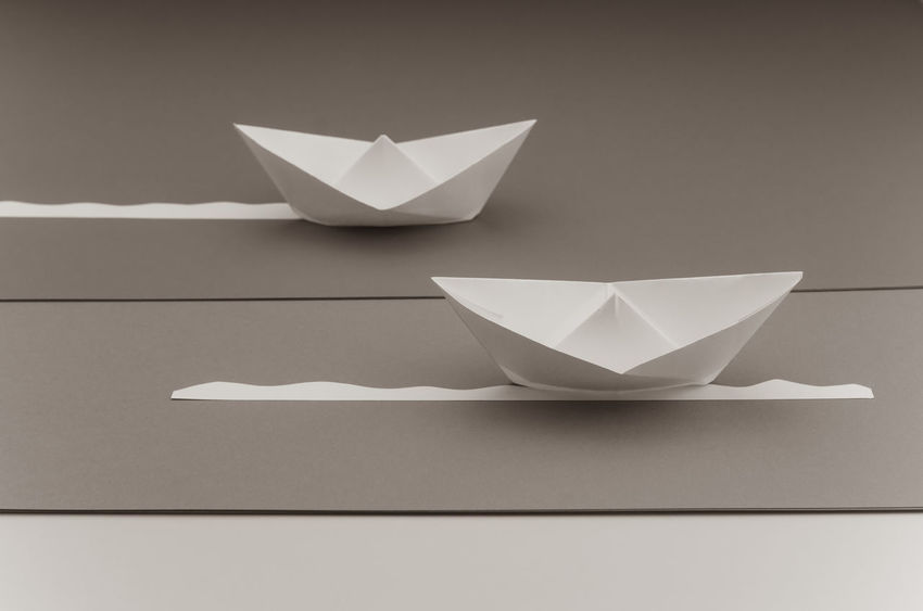 paper sailing boats Art And Craft Clean Close-up Copy Space Craft Creativity Folded Indoors  No People Origami Paper Paper Boat Paper Boats Paperwork Representation Sailing Boats Shape Single Object Still Life Studio Shot Table White White Color