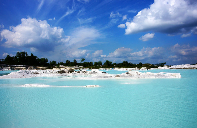 Man-made artificial lake Kaolin, turned from a mining ground holes. Land contains kaolinite and is white. Due to mining, holes were formed. and were covered by rain water, forming a clear blue lake, Air Raya Village, Tanjung Pandan, Belitung Island. Beauty In Nature Belitung Island Belitung, Indonesia Blue Bright Water Clear Water Clearwater Day Island Kaolin Kaolin Lake Kaolinite Lake Landscape Nature No People Outdoors Tranquility Travel Travel Destinations Water White Color