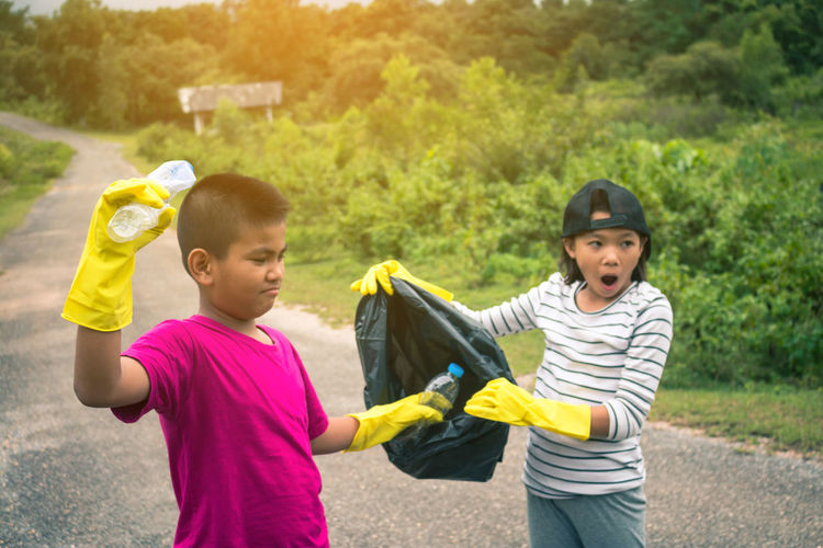 Volunteer Boys Child Childhood Elementary Age Garbage Garbage Collection Girls Group Of Children Holding Holiday - Event Outdoors People Togetherness Two People