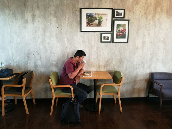 coffee shop Coffee - Drink Coffee Shop People One Person Chairs Backgrounds Sitting Full Length Chair Domestic Life