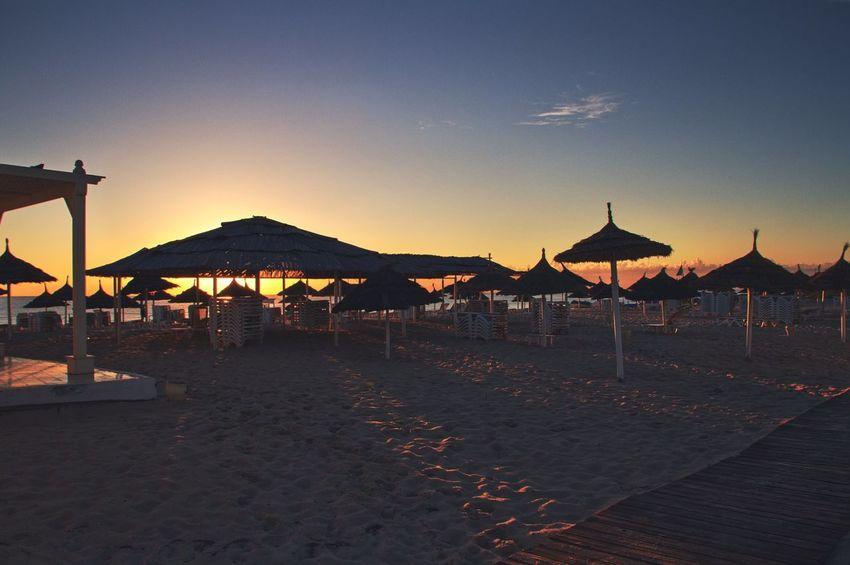 Beach Dawn Light Long Shadows Outdoors Parasol Sand Sea And Sky Sunlight Sunrise Tunisia Vacations