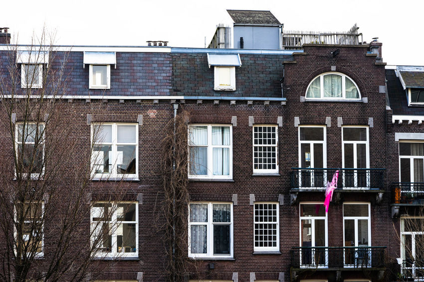 Traditional Dutch residential house Amsterdam Architecture Netherlands Pink Architecture Brick Building Building Exterior Built Structure Day Dutch Europe House Lowland No People Outdoors Residential Building Sky Spring Window Windows Wooden