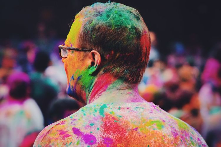 Close-up of colorful man during holi
