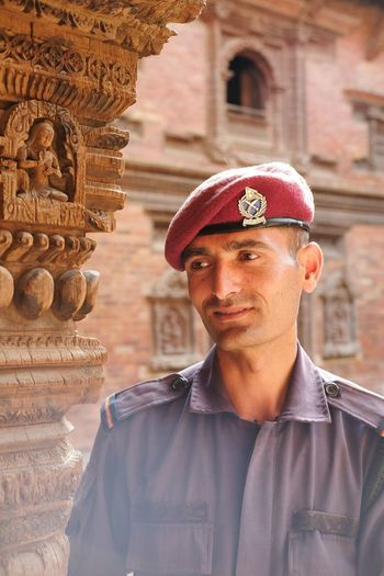 EyeEmNewHere Man Nepal Uniform Architecture Portrait Built Structure One Person Building Exterior Looking At Camera Real People Headshot Men Travel Destinations Hat History