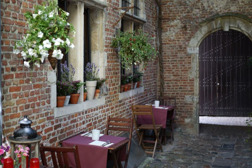 Architecture Building Exterior Built Structure Flower Brick Wall Outdoors No People Blossom Day Romantic Place Old Architecture Place To Eat Bistro Tables Brickswork Bricks And Stones Romantic Scenery