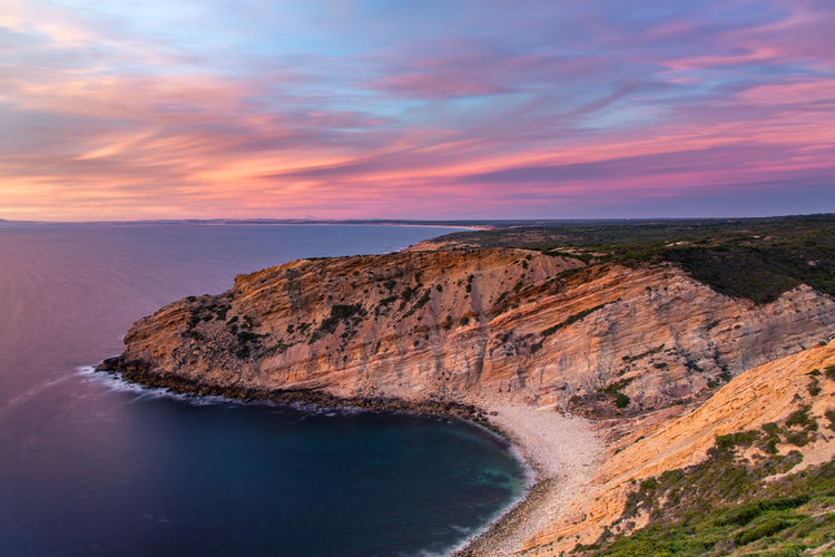 Portugal West coast at Cabo Espichel, Sesimbra Beauty In Nature Cliff Cloud - Sky Horizon Over Water Idyllic Landscape Nature No People Outdoors Physical Geography Rock - Object Scenics Sea Sky Sunset Tranquil Scene Tranquility Travel Destinations Water Waterfront