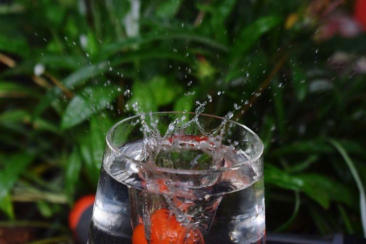 Close-up of water splashing in glass