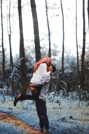 Couple romancing in forest