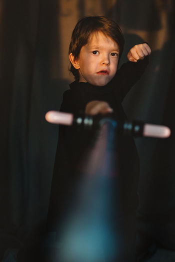 Boy playing with sword at theater