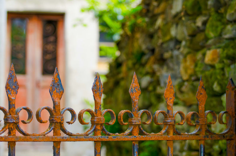 Rusta Metal Gate Plant Architecture Barrier Boundary Building Built Structure Close-up Day Door Fence Focus On Foreground Gate Iron - Metal Metal No People Outdoors Protection Railing Rusty Safety Security Selective Focus Sharp Wrought Iron