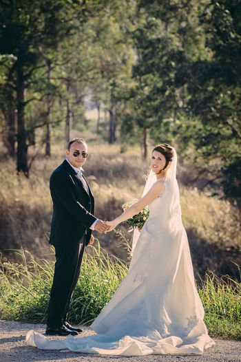 Adult Bride Bridegroom Celebration Couple - Relationship Event Females Full Length Life Events Love Married Men Newlywed Outdoors Plant Positive Emotion Real People Tree Two People Wedding Wedding Ceremony Wedding Dress Wife Women