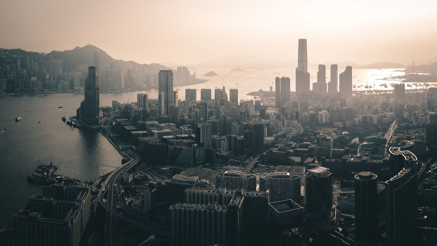 Cityscape and victoria harbour during sunset