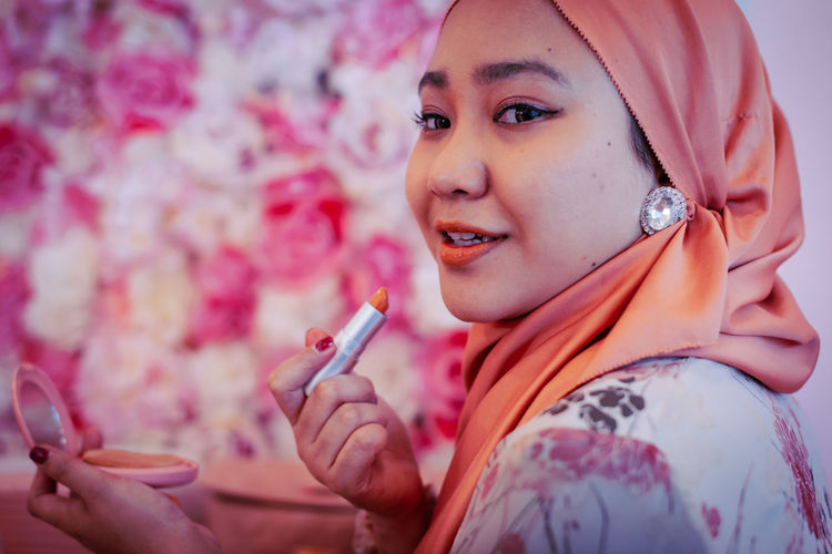 Portrait of woman holding cigarette