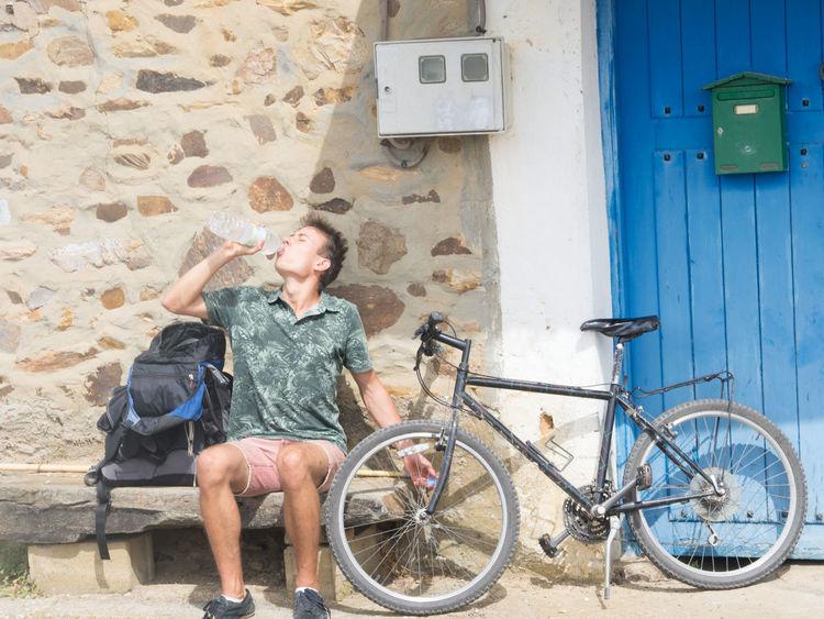 Bike Boy Break Bycicle Camino De Santiago Cyclist Drinking Drinking Water Exhausted Leisure Activity Pilgrim Pilgrimage Rest SPAIN Take A Break Teen Teenager Tour Travel Photography Traveling Trekking Way Of Saint James Young Young Man