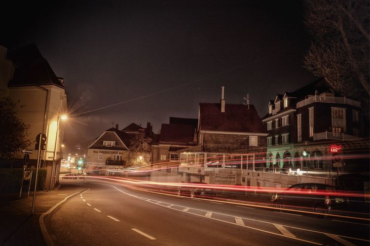 Langzeitbelichtung in Gummersbach Night Light Trail Illuminated Speed Architecture Long Exposure Building Exterior Street Built Structure Motion Transportation Road Street Light City High Street Sky No People Outdoors Urban Scene Oberberg Gummersbach First Eyeem Photo